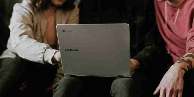 College students with Chromebook laptop